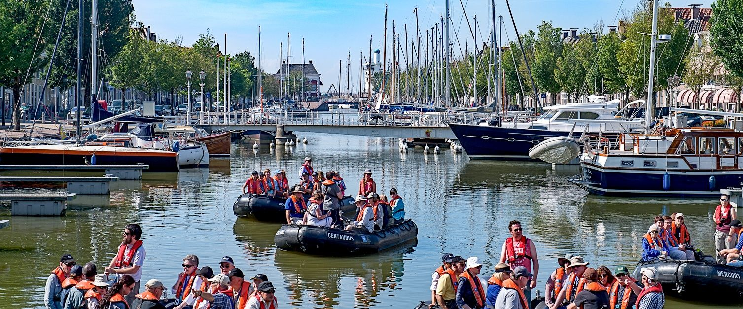 Passengers Exploring the Canals of Harlingen, Holland